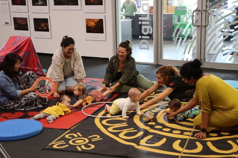 Families take part in the Wayapa Babytime program at Newcastle Libraries.