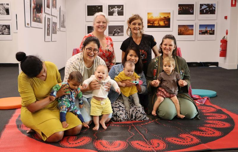 (Back) Newcastle Councillor Carol Duncan and Sarah Corrigan from Rainbow Crow Cultural Collective with Wayapa Babytime participants (front) Svetlana and Danny (6 months), Fon and Noah (6 months), Anh and Matilda (5 months), and Tamara and Rumi (9 months).