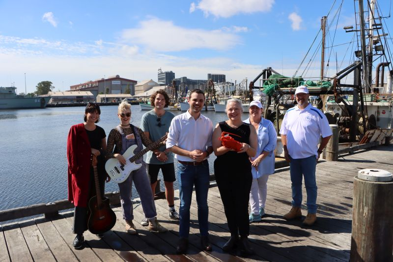(Front) Newcastle Deputy Lord Mayor Declan Clausen and Councillor Carol Duncan with (rear left) Live Music Grant recipients Monique Humphreys and Kodi Twiner (who are organising the Prickly Pear event at The Base Health), Beach Burrito Company - Newcastle Venue Manager Henry Smale, and (rear right) Newcastle Seafood Festival organiser Lynne Hopson with Newcastle Fisherman's Co-op General Manager Rob Gauta.